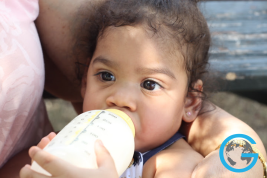 Baby Girl with her Baby Bottle