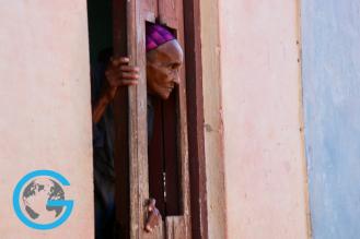 Woman Overlooks Streets of Trinidad, Cuba